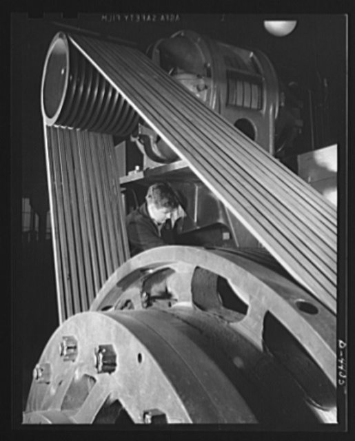 Production. Pipe fittings. The V-belt drive of the world's largest machine of its kind, a nine inch upsetter. The machine is used in a Midwest plant to forge 75 mm shells for the Army. Tube Turn Incorporated