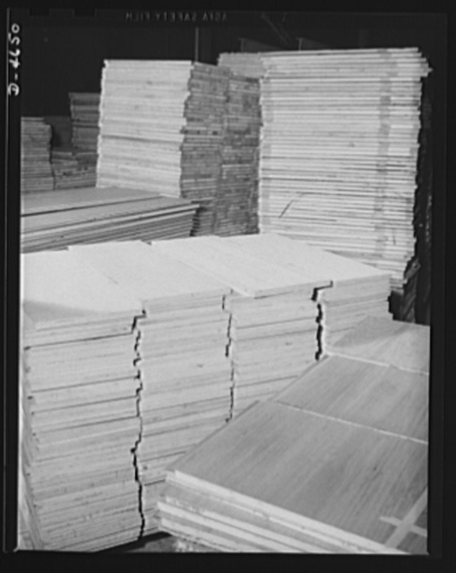 Production. Plywood for aircraft and boats. Plywood panels for combat planes and boats. These panels, produced in a Midwest plant, have remarkable properties. The synthetic resins used as adhesives make a bond that is stronger than the wood itself, and they resist water so well that they may be boiled without injury. Louisville, Kentucky
