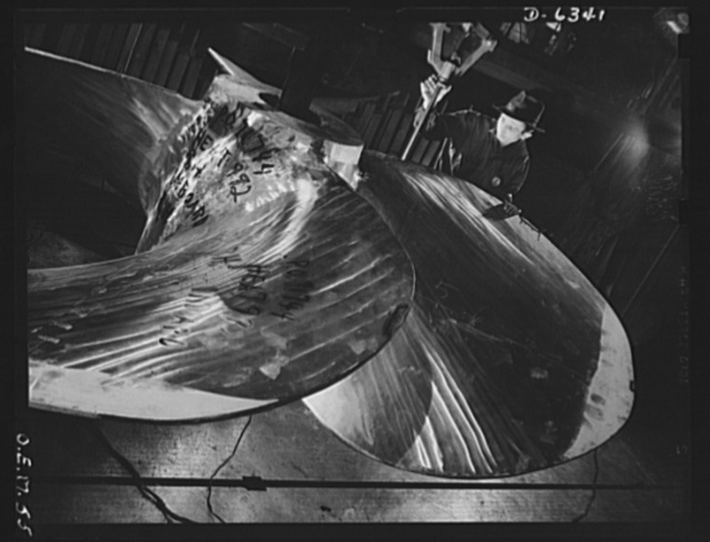 Production. Ship propellers, etc. A massive ship propeller of manganese bronze is calibrated for later machine operations. The huge war production plant in which it was made is also turning out tanks and locomotives. Baldwin Locomotive Works