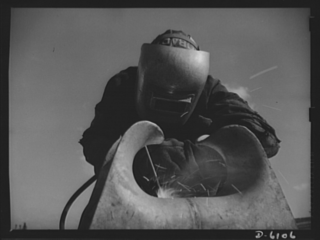 Production. Submarine chasers. An answer to the U-boats: more subchasers. A husky arc welder has just finished a job on one of the chocks of a chaser at an Eastern boatyard. Marine Construction Company, Stamford, Connecticut