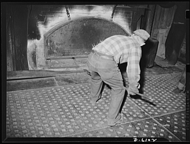 Production. Submarine chasers. Bending pipe fittings for new subchasers. The heating furnaces and bending floor of an Eastern boatyard are kept busy as one Navy boat after another is built and fitted. Marine Construction Company, Stamford, Connecticut