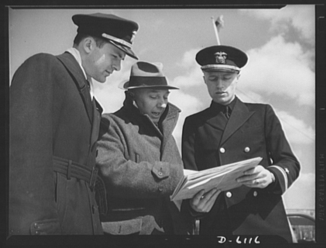 Production. Submarine chasers. Ready to harry the U-boat. The skipper and executive officer assigned to a subchaser nearing completion at an Eastern boatyard discuss the specifications of their new command with the government inspector who approved the job. Marine Construction Company, Stamford, Connecticut