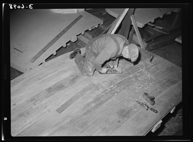 Production. Submarine chasers. The transom, or stern piece, of a wooden subchaser for the Navy is planed smooth before it is attached to the keel at an Eastern boatyard. Marine Construction Company, Stamford, Connecticut