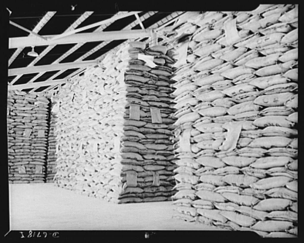 Production. Tin smelting. Raw tin from South American mines is stored at a Southern smelter where the pure metal will be extracted to meet the countless war needs of the United Nations. Each stack of bags represents a fifteen thousand dollar value