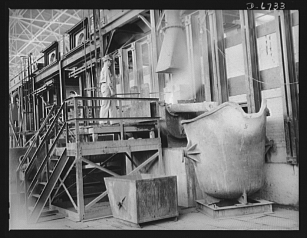Production. Tin smelting. Removing slag after tapping a furnace in a Southern tin smelter. The tin extracted from the ore has already been drawn off into floats for further refining. The slag is then run off to the right into ladles which will carry it to recooking operations. The slag is reintroduced to the process for further recovery of the metal