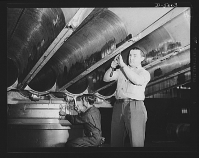 Production. Torpedo tube mounts. A torpedo tube mount in the final assembly stage at a Midwest machine shop engaged in volume production of mounts for torpedo tubes and large naval guns. Westinghouse, Louisville