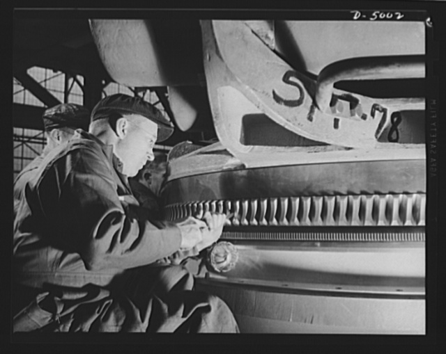 Production. Torpedo tube mounts. Scraping the teeth of a torpedo tube base in a Midwest plant engaged in large-scale production of mounts for torpedo tubes and large naval guns. Westinghouse, Louisville