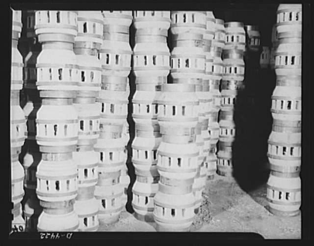 Production. Wagon wheels. Finished wagon wheel hub assemblies piled in the plant of a Southern wagon builder who is receiving a great demand for his products on account of the rubber shortage
