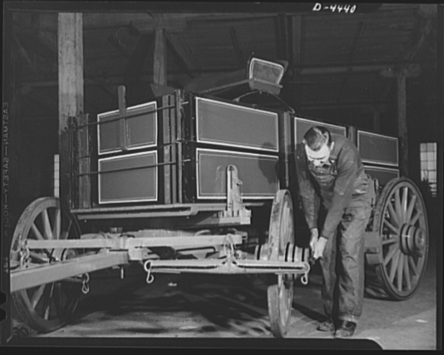 Production. Wagon wheels. From the wagon assembly of a Southern wagon plant comes this once familiar vehicle which is being built in great volume these days as a result of the rubber shortage. This worker is giving a farm wagon the final once-over