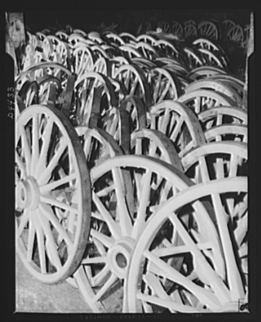 Production. Wagon wheels. Wagon wheels for America's farmers. Wagon wheel assemblies ready for painting in the plant of a Southern wheel company which is having boom business these days on account of the rubber shortage