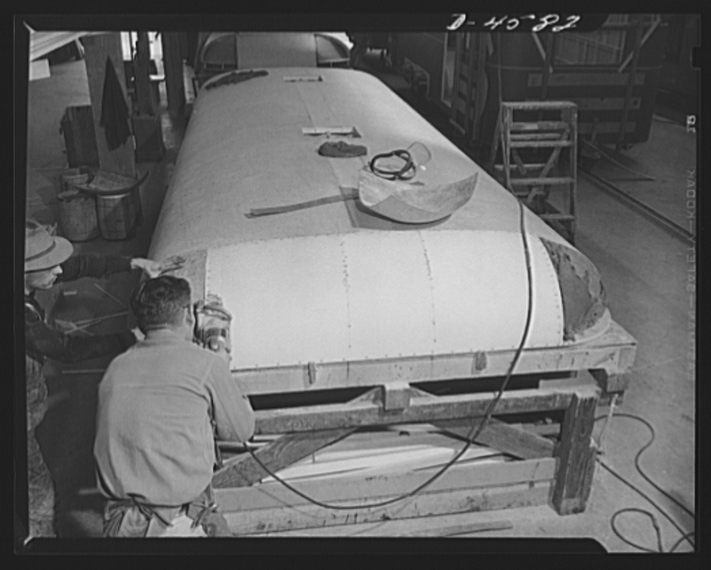 Production. War housing trailers. The top of a war housing trailer is assembled and finished in the Los Angeles plant of Western Trailer Company. Corners are plastic, rounded sections made of paper especially treated to give it great hardness and durability