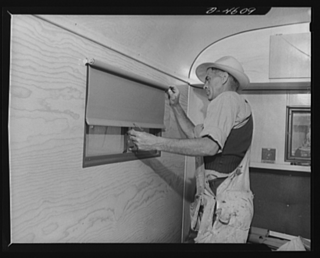 Production. War housing trailers. When windows are in place, opaque blackout blinds are installed in war housing trailers under construction at the Los Angeles plant of Western Trailer Company. Light-weight shields are installed at the top and sides to prevent light leaks