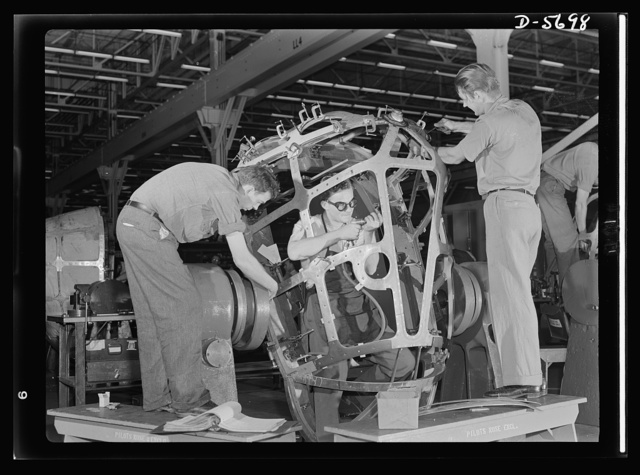 Production. Willow Run bomber plant. Advanced assembly includes riveting and drilling the nose of the bomber made in the giant Willow Run plant. Open spaces will be fitted with a form of Plexiglas to give the bombardier a complete wide-angle view. Ford plant, Willow Run