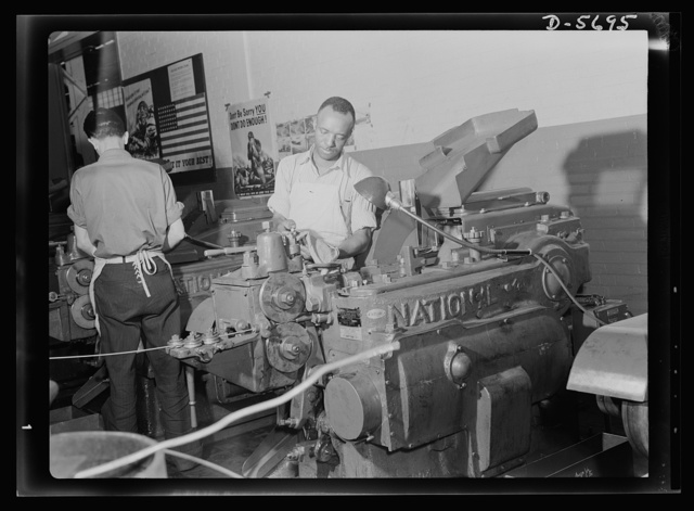 Production. Willow Run bomber plant. An experienced Negro worker at the Willow Run bomber plant operates a cold heading machine which makes hundreds of rivets a minute from aluminum alloy wire. Ford plant, Willow Run