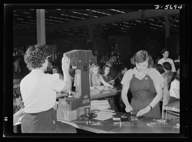 Production. Willow Run bomber plant. Experienced women workers at the Willow Run bomber plant operate such machines as this Rockwell hardness tester (left). Beginners are given such tasks as numbering small machine parts (right). Ford plant, Willow Run