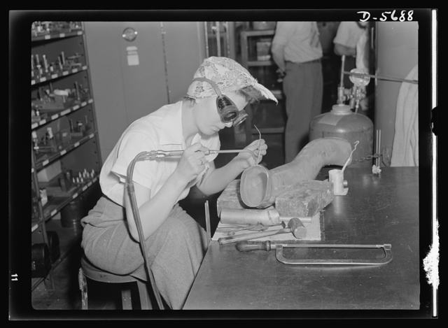 Production. Willow Run bomber plant. Steady of eye and hand, women workers at the great Willow Run bomber plant are among those throughout the country who are relieving serious shortages of skilled workers by doing such semi-skilled jobs as the one shown here. She's welding parts of the cooling system direct to the supercharger. Ford plant, Willow Run