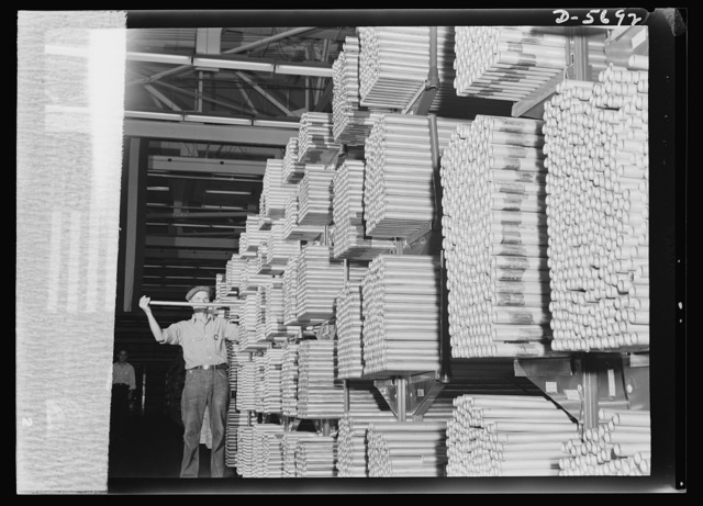 Production. Willow Run bomber plant. Thousands of miles of tubing, stacked in one of Willow Run's enormous supply rooms, await bending. More than a thousand separate tubing pieces go into the fuel, de-icing, hydraulic and other systems of a bomber plane. Ford plant, Willow Run