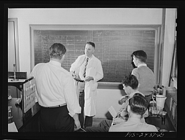 Professor M.P. Baker lecturing a senior class in bacteriology at Iowa State College. Ames, Iowa