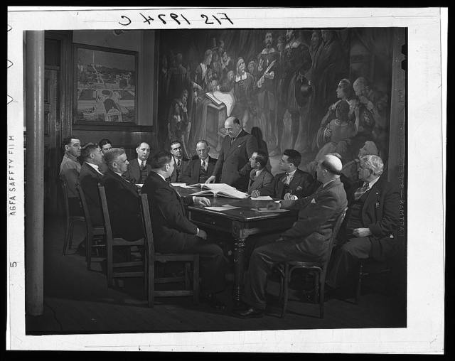 Provincetown, Massachusetts. City fathers of Provincetown, all of Portuguese descent, gathered in council, before a painting representing the signing of the Pilgrim compact in the bay of Provincetown upon the first landing of the Pilgrims on American soil