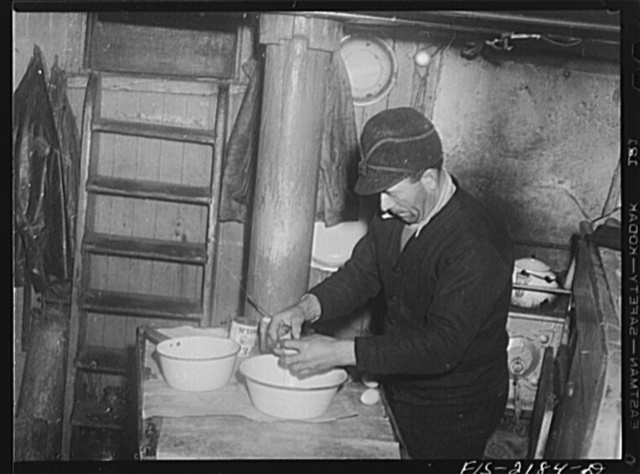 Provincetown, Massachusetts. Getting breakfast aboard the Portugese trawler, Frances and Marion