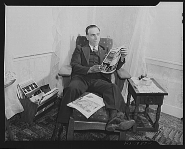 Provincetown, Massachusetts. John Russe, Jr., a Portuguese fisherman, reading at home on Sunday evening
