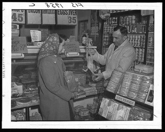 Provincetown, Massachusetts. Mrs. John Russe shopping in a Portuguese store
