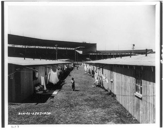 Puyallup (Wash.) Assembly Center - rafters from barrack buildings make convenient extensions for a clothesline