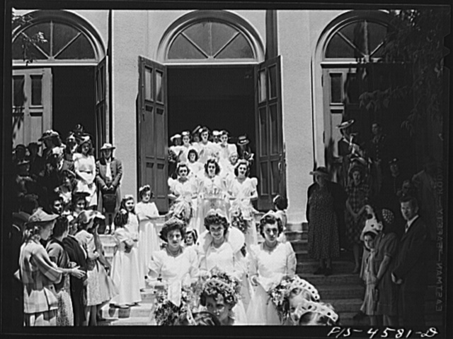 Queen and her court of the fiesta of the Holy Ghost leave church. Santa Clara, California