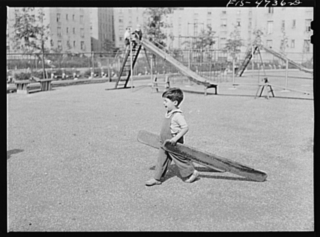 Queens, New York. Child playing with boards at the nursery school at the Queensbridge housing project