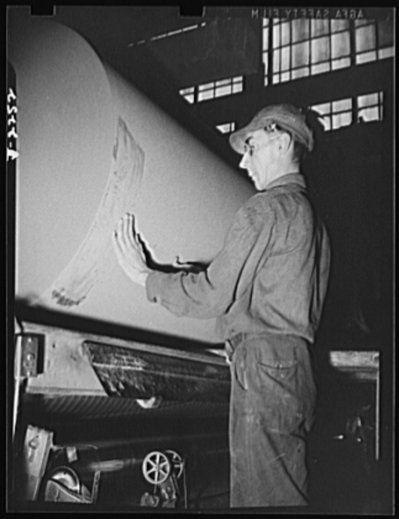 Rags. Collection and processing. A roll of roofing felt being sealed at a Maryland plant. Rags and waste paper are used extensively in the manufacture of this material. Shapiro Company, Baltimore, Maryland