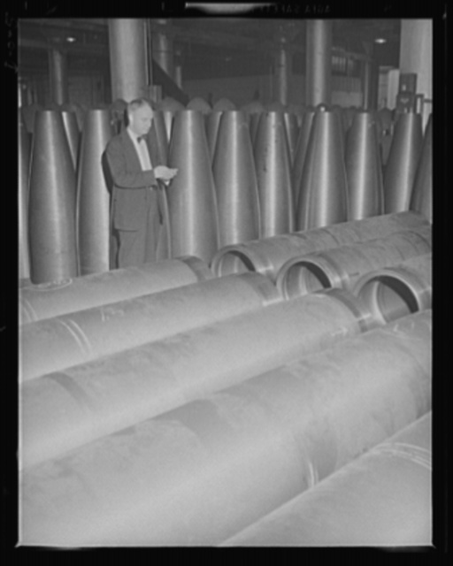 Ready for 1000 pounds of TNT. Checking up on torpedo parts which are being turned out at top speed for the two-ocean Navy at an eastern Navy arsenal