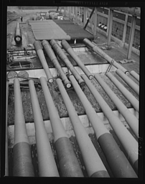 Ready for battle. Finished guns of large caliber awaiting shipment in an eastern Navy yard. This is just one of the eleven Navy arsenals which are producing guns for the two-ocean fleet