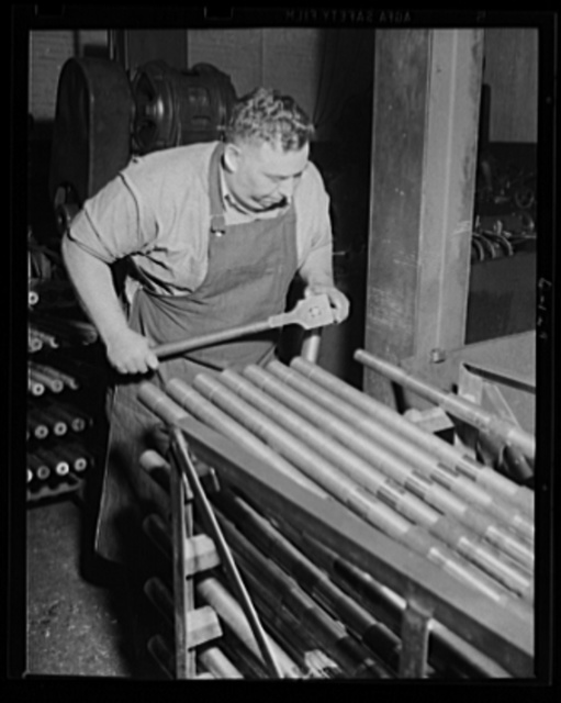 Ready for the next step. This workman is preparing a 50-caliber machine gun barrel for turning as war work preparation put work at an Eastern armory into high gear