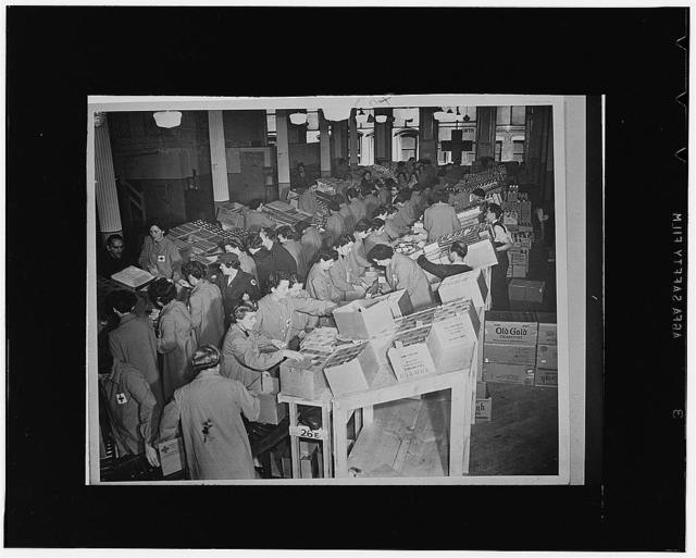 Red Cross workers packing boxes to go to the United States Armed Forces and prisoners of war