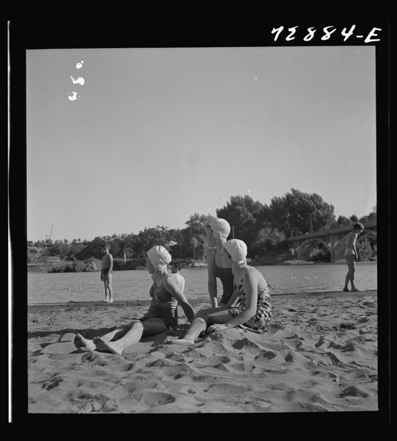 Redding, California. Young people on the beach of the Sacramento River