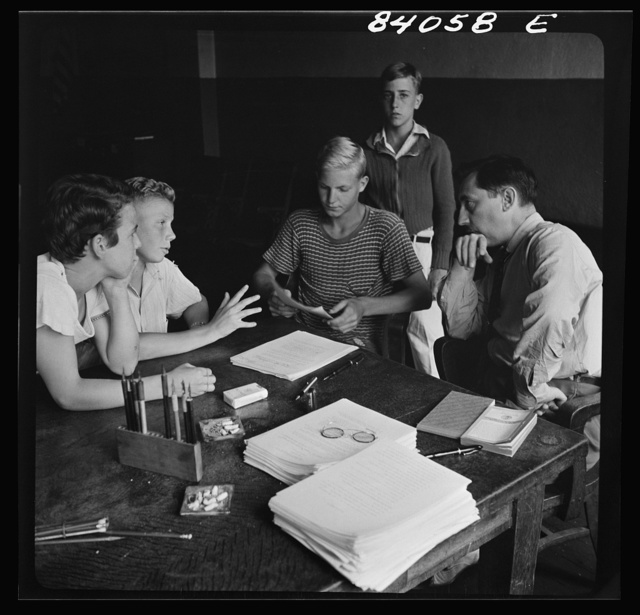 Richwood, West Virginia. A high school boy who is slightly under age is trying to convince the FSA (Farm Security Administration) representative that he should go to New York state to help bring in the harvest
