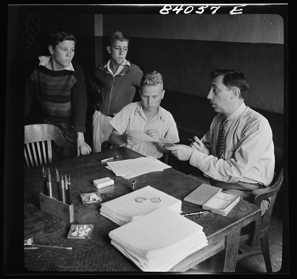 Richwood, West Virginia. FSA (Farm Security Administration) representative signing up high school boys to go by special train to upper New York state to help bring in the harvest