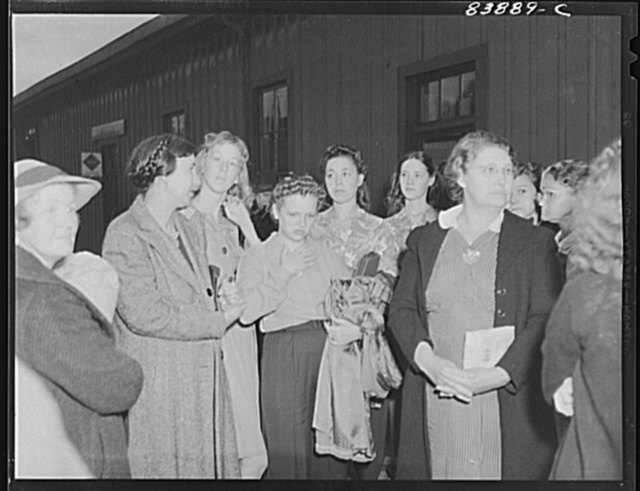 Richwood, West Virginia. Women and girls waiting to board train for Batavia, New York where they will work in the harvest