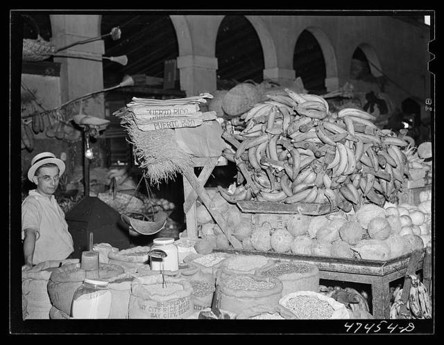 Rio Piedras, Puerto Rico. Bananas, coconuts, rice, beans and other produce for sale at the produce market