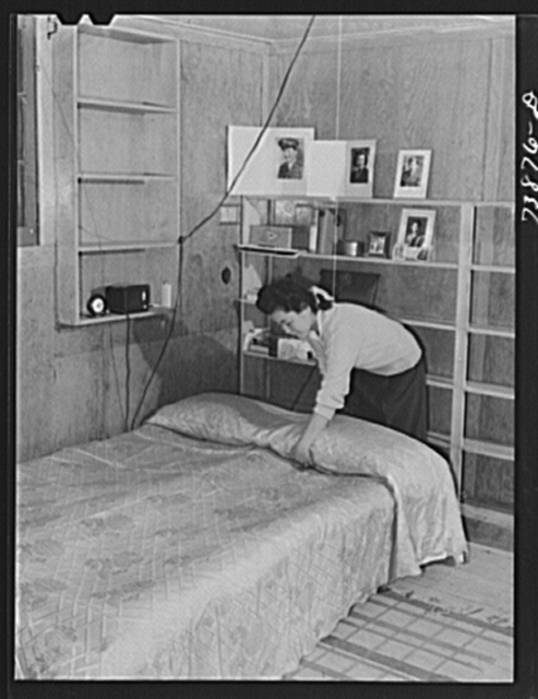 Rupert, Idaho. Former CCC (Civilian Conservation Corps) camp now under FSA (Farm Security Administration) management. A Japanese-American girl in the apartment she has arranged for her husband and herself in the barracks building
