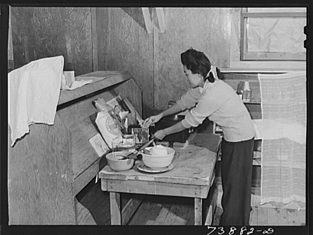Rupert, Idaho. Former CCC (Civilian Conservation Corps) camp now under FSA (Farm Security Administration) management. A Japanese-American girl in the apartment she has arranged for her husband and herself in the barrack building