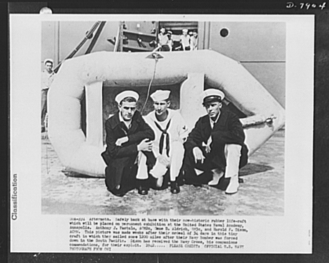 Safety equipment. Rubber lifeboats. Aftermath. Safely back at base with their now historic rubber life raft which will be placed on permanent exhibition at the U.S. Naval Academy, Annapolis. Anthony J. Pastula, AOM2c, Gene D. Aldrich, RM3c, and Harold F. Dixon, ACMM. This picture was made weeks after their ordeal of thirty-four days in this tiny craft in which they sailed some 1200 miles after their Navy bomber was forced down in the South Pacific. Dixon has received the Navy Cross, his companions commendations for their exploits