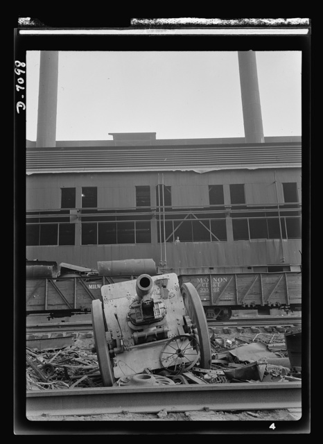 Salvage. Scrap for steel mills. A cannon that saw duty in World War I stands in the yard of a Chicago steel mill, ready to be melted down and processed into a modern weapon for World War II