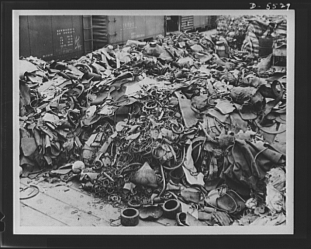 Salvage. Scrap rubber collection. Have you any old rubber lying around? Look at this picture closely and you will find many things that you too can contribute to the national scrap rubber pile. This accumulation in the yards of the Dowenthal Company in Akron, Ohio, contains old bicycle tires, hot water bottles, fruit jar rings, rubber heals and soles, floor mats, tire patches, hose connections, tubing, gaskets, fan belts, washers, in fact, everything but rubber checks