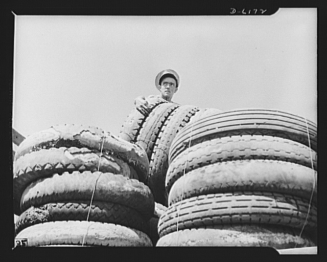Salvage. Scrap tires. On their way to swell America's most important  stockpile. Employees of a large Southern junkyard load scrap tires for shipment to a reclaiming plant where the rubber will be removed and processed into essential war materials