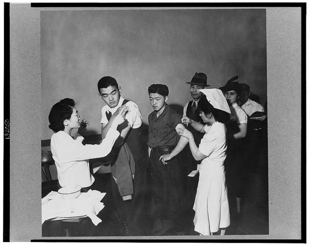 San Francisco, Calif., Apr. 1942 - evacuees of Japanese descent being inoculated as they registered for evacuation, and assignment, later, to war relocation authority centers for the duration of the war