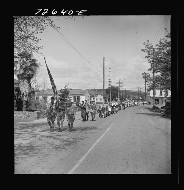 San Juan Bautista, California. Schoolchildren parade with scrap metal they have collected for the war