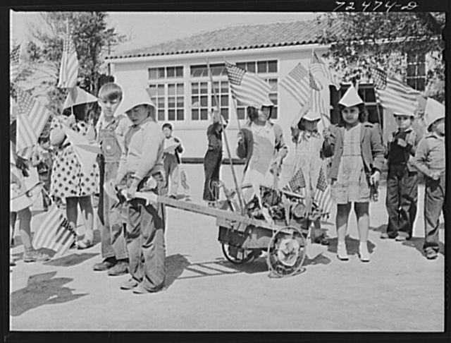 San Juan Bautista, California. Schoolchildren parading with scrap metal they have collected for the war