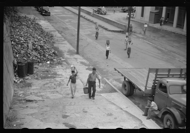 San Juan, Puerto Rico. People carrying water home because of the failure of the water system for three days