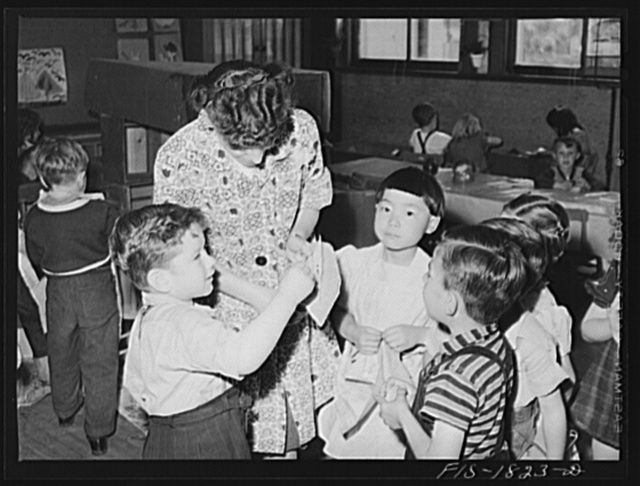 San Leandro, California. Kindergarten children and their teacher. About seventy percent of the school children in this community are of Portuguese descent. Their schoolmates are of Spanish, Italian, English, German, Mexican, Chinese and Japanese descent